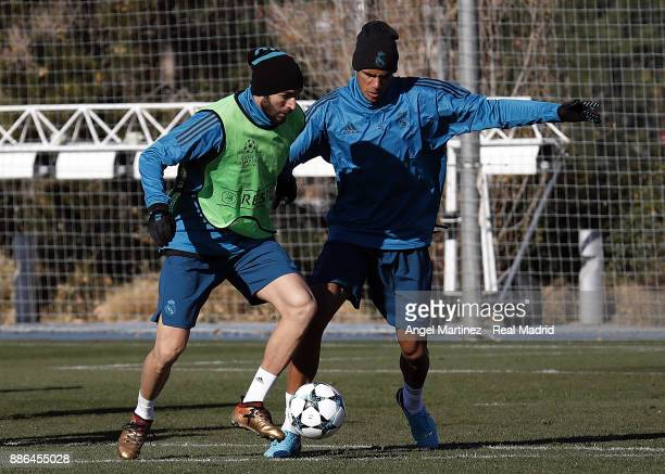 Karim Benzema and Raphael Varane of Real Madrid in action during a training session at Valdebebas training ground on December 5 2017 in Madrid Spain