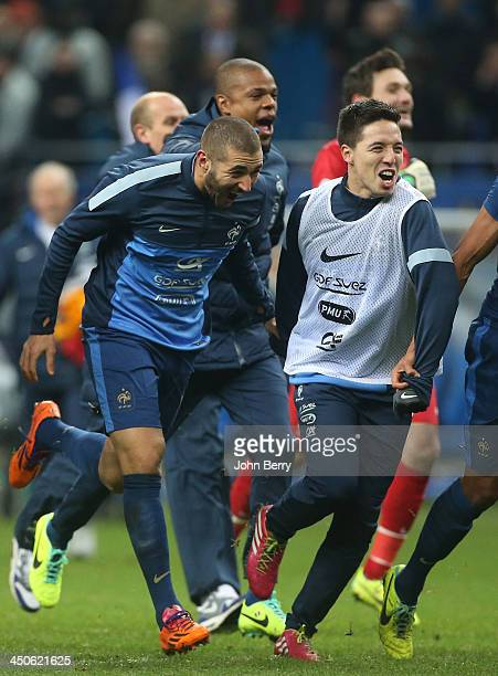 Karim Benzema and Samir Nasri of France celebrate the victory at the end of the FIFA 2014 World Cup Qualifier playoff second leg match between France...