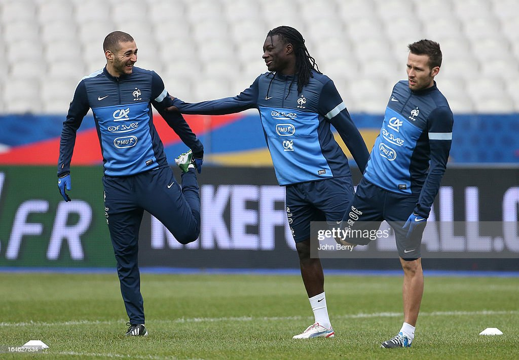Karim Benzema, Bafetimbi Gomis, Yohan Cabaye of France stretch during a training session the day before the FIFA World Cup 2014 qualifier between France and Spain at the Stade de France on March 25, 2013 in Saint-Denis near Paris, France.