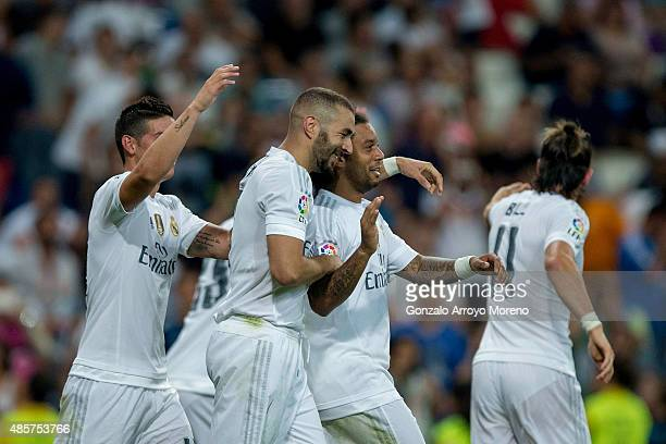 Karim Benzema celebrates scoring their third goal with teammates James Rodriguez Marcelo and Gareth Bale during the La Liga match between Real Madrid...