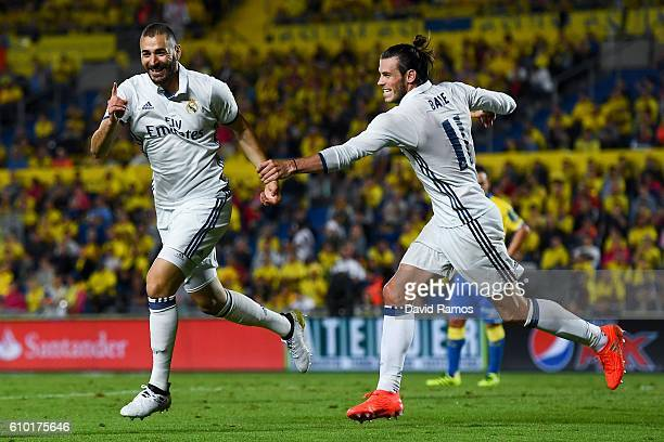 Karim Benzema celebrates with his team mate Gareth Bale after scoring his team's second goal of Real Madrid CF during the La Liga match between UD...