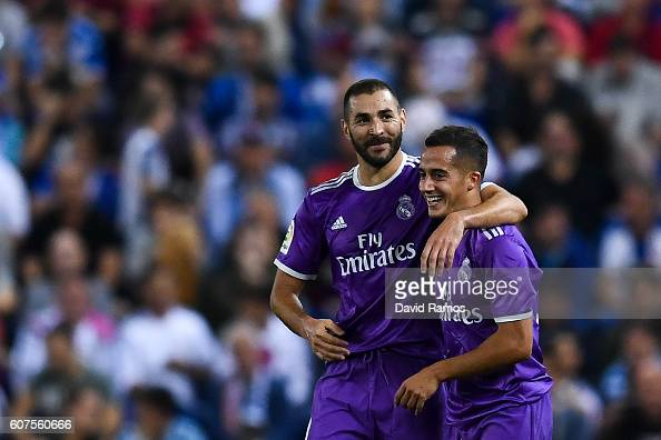 Karim Benzema celebrates with his team mate Lucas Vazquez of Real Madrid CF after scoring his team's second goal during the La Liga match between RCD...