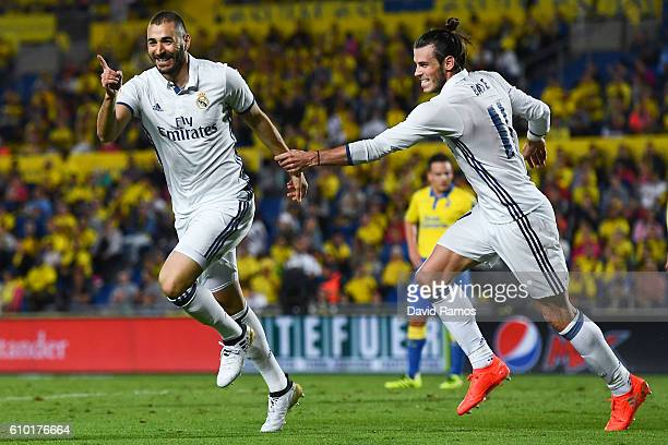 Karim Benzema celebrates with his team mates after scoring his team's second goal of Real Madrid CF during the La Liga match between UD Las Palmas...
