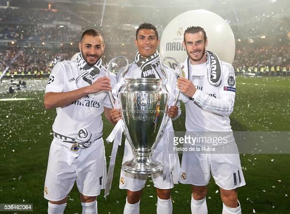 Karim Benzema Cristiano Ronaldo and Gareth Bale of Real Madrid CF during Real Madrid CF team celebration at Santiago Bernabeu Stadium the day after...