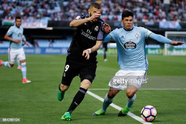 Karim Benzema forward of Real Madrid battles for the ball with Facundo Roncaglia defender of Celta de Vigo during the La Liga Santander match between...