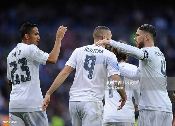 Karim Benzema Gareth Bale of Real Madrid celebrates with Danilo and Sergio Ramos after scoring his team's 10th goal during the La Liga match between...