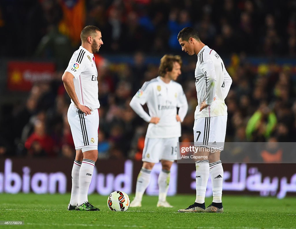 Karim Benzema, Luka Modric and Cristiano Ronaldo of Real Madrid CF look dejected as Luis Suarez of Barcelona scores their second goal during the La Liga match between FC Barcelona and Real Madrid CF at Camp Nou on March 22, 2015 in Barcelona, Spain.