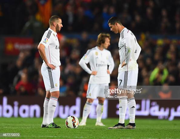 Karim Benzema Luka Modric and Cristiano Ronaldo of Real Madrid CF look dejected as Luis Suarez of Barcelona scores their second goal during the La...