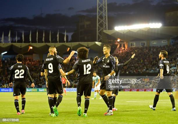 Karim Benzema Marcelo and Cristiano Ronaldo of Real Madrid celebrates the third goal against RC Celta during the La Liga match between Celta Vigo and...