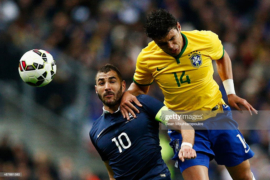Karim Benzema of France and Thiago Silva of Brazil battle for the header during the International Friendly match between France and Brazil at the Stade de France on March 26, 2015 in Paris, France.