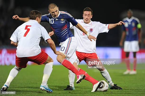 Karim Benzema of France and Tom Schnell and Gilles Bettmer of Luxembourg during the Group D UEFA 2012 Qualifying match between France and Luxembourg...