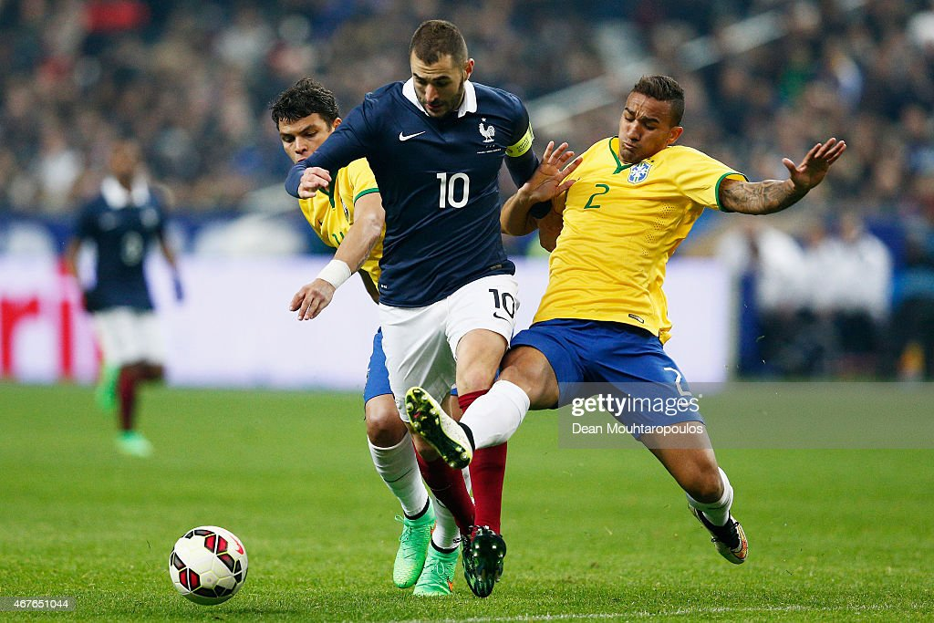 <a gi-track='captionPersonalityLinkClicked' href=/galleries/search?phrase=Karim+Benzema&family=editorial&specificpeople=796089 ng-click='$event.stopPropagation()'>Karim Benzema</a> of France battles for the ball with Danilo and <a gi-track='captionPersonalityLinkClicked' href=/galleries/search?phrase=Thiago+Silva+-+Soccer+Player+-+Born+1984&family=editorial&specificpeople=11499440 ng-click='$event.stopPropagation()'>Thiago Silva</a> of Brazil during the International Friendly match between France and Brazil at the Stade de France on March 26, 2015 in Paris, France.