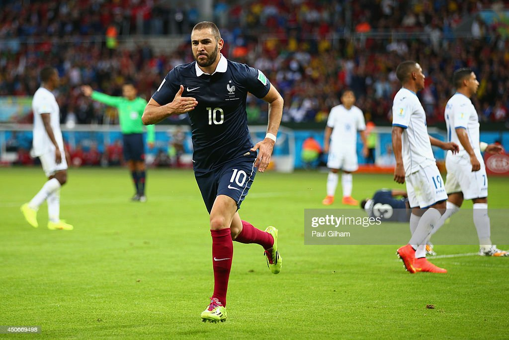 <a gi-track='captionPersonalityLinkClicked' href=/galleries/search?phrase=Karim+Benzema&family=editorial&specificpeople=796089 ng-click='$event.stopPropagation()'>Karim Benzema</a> of France celebrates after scoring his team's third goal during the 2014 FIFA World Cup Brazil Group E match between France and Honduras at Estadio Beira-Rio on June 15, 2014 in Porto Alegre, Brazil.