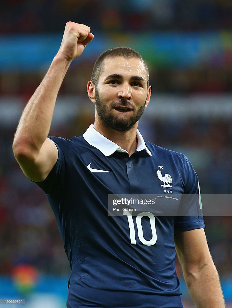Karim Benzema of France celebrates after scoring his team's third goal during the 2014 FIFA World Cup Brazil Group E match between France and...