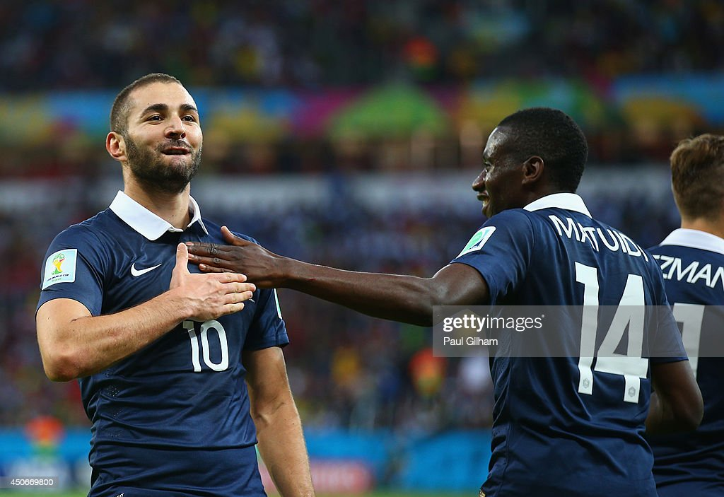 <a gi-track='captionPersonalityLinkClicked' href=/galleries/search?phrase=Karim+Benzema&family=editorial&specificpeople=796089 ng-click='$event.stopPropagation()'>Karim Benzema</a> of France (L) celebrates after scoring his team's third goal with teammate <a gi-track='captionPersonalityLinkClicked' href=/galleries/search?phrase=Blaise+Matuidi&family=editorial&specificpeople=801779 ng-click='$event.stopPropagation()'>Blaise Matuidi</a> during the 2014 FIFA World Cup Brazil Group E match between France and Honduras at Estadio Beira-Rio on June 15, 2014 in Porto Alegre, Brazil.