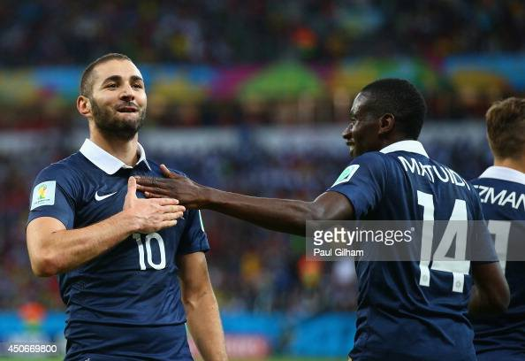 Karim Benzema of France celebrates after scoring his team's third goal with teammate Blaise Matuidi during the 2014 FIFA World Cup Brazil Group E...