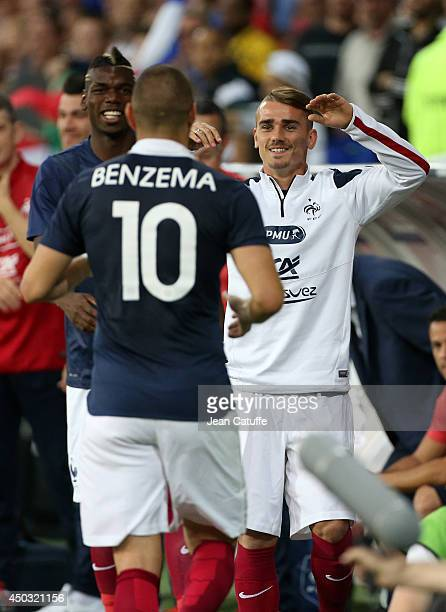 Karim Benzema of France celebrates his first goal with Paul Pogba and Antoine Griezmann of France during the international friendly match between...