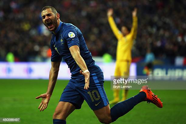 Karim Benzema of France celebrates scoring during the FIFA 2014 World Cup Qualifier Playoff second leg match between France and Ukraine at the Stade...