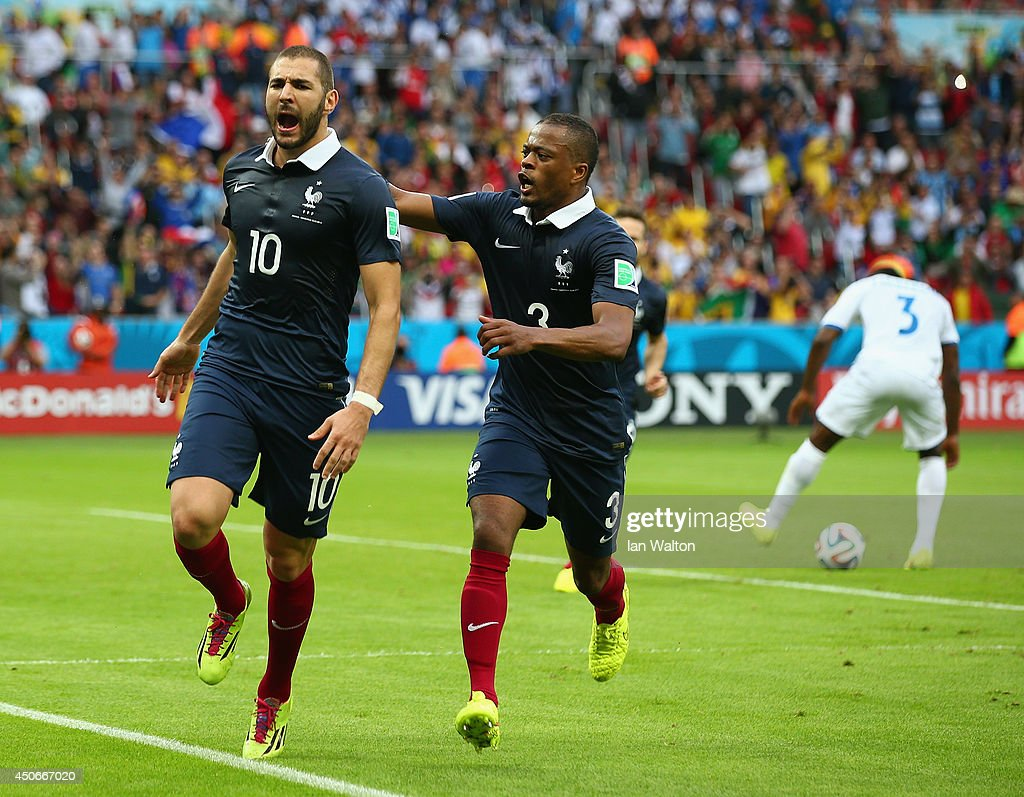 <a gi-track='captionPersonalityLinkClicked' href=/galleries/search?phrase=Karim+Benzema&family=editorial&specificpeople=796089 ng-click='$event.stopPropagation()'>Karim Benzema</a> of France celebrates scoring his team's first goal on a penalty kick with <a gi-track='captionPersonalityLinkClicked' href=/galleries/search?phrase=Patrice+Evra&family=editorial&specificpeople=714865 ng-click='$event.stopPropagation()'>Patrice Evra</a> during the 2014 FIFA World Cup Brazil Group E match between France and Honduras at Estadio Beira-Rio on June 15, 2014 in Porto Alegre, Brazil.