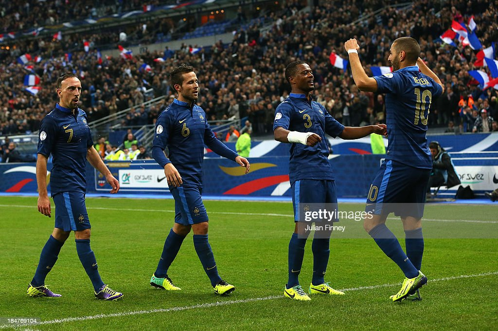 Karim Benzema of France celebrates scoring his teams third goal with team mates, Patrice Evra, Yohan Cabaye and Franck Ribery of France during the FIFA 2014 World Cup Qualifying Group I match between France and Finland at the Stade de France on October 15, 2013 in Paris, France.