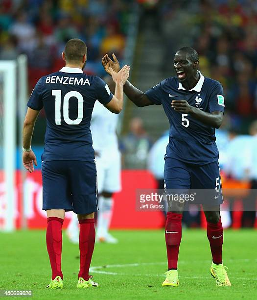 Karim Benzema of France celebrates scoring his team's third goal with teammate Mamadou Sakho during the 2014 FIFA World Cup Brazil Group E match...