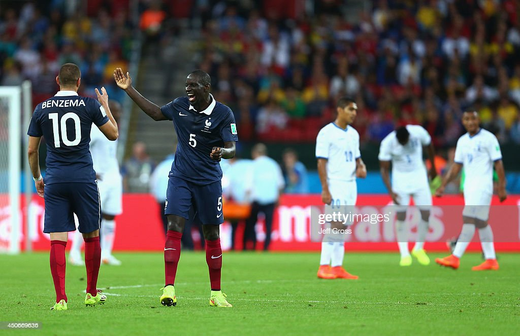 Karim Benzema of France (L) celebrates scoring his team's third goal with teammate Mamadou Sakho during the 2014 FIFA World Cup Brazil Group E match between France and Honduras at Estadio Beira-Rio on June 15, 2014 in Porto Alegre, Brazil.