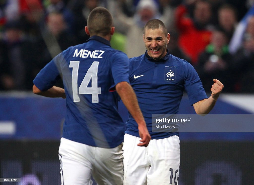 Karim Benzema of France celebrates with Jeremy Menez after scoring the winning goal during the International friendly match between France and Brazil at Stade de France on February 9, 2011 in Paris, France.
