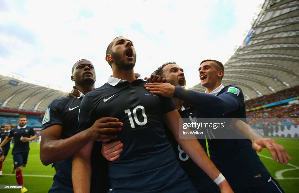 Karim Benzema of France (2nd L) celebrates with teammates after scoring his team's first goal on a penalty kick during the 2014 FIFA World Cup Brazil Group E match between France and Honduras at Estadio Beira-Rio on June 15, 2014 in Porto Alegre, Brazil.