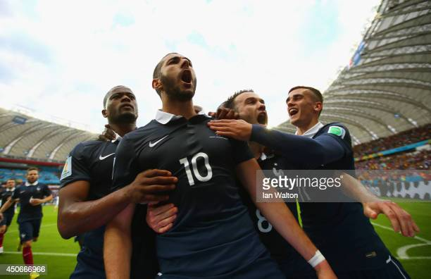 Karim Benzema of France celebrates with teammates after scoring his team's first goal on a penalty kick during the 2014 FIFA World Cup Brazil Group E...