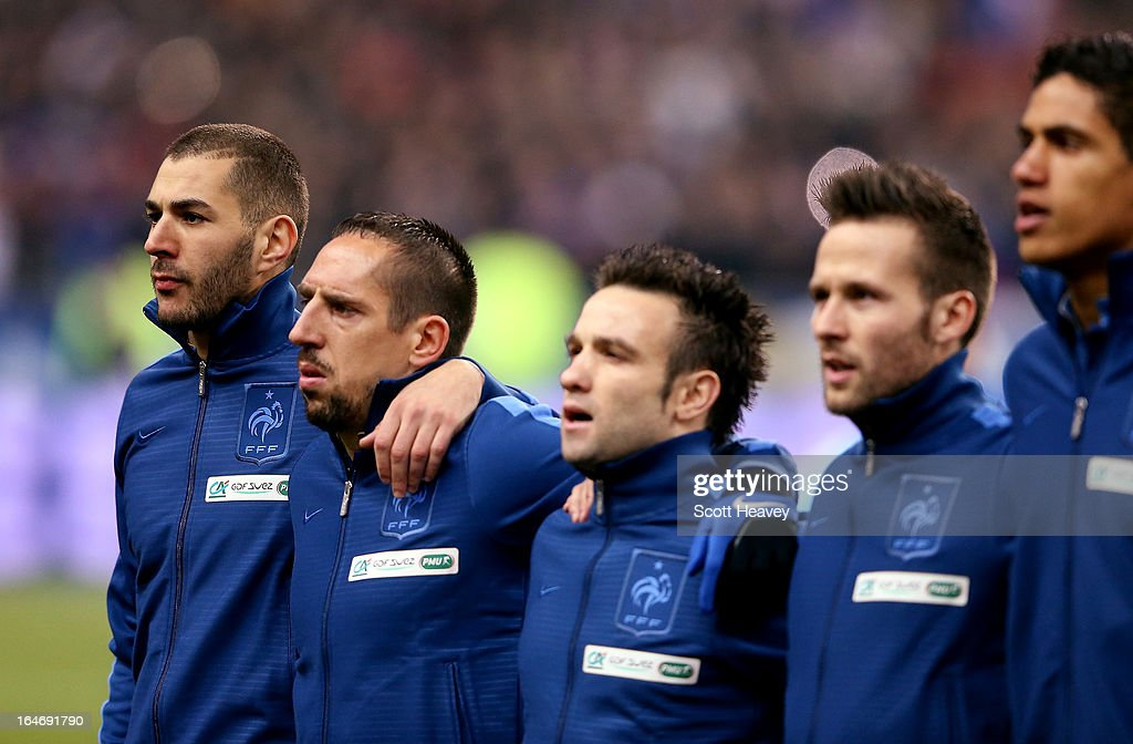 Karim Benzema of France (L) during the national anthem during a FIFA 2014 World Cup Qualifier between France and Spain at Stade de France on March 26, 2013 in Paris, France.