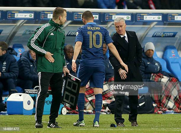 Karim Benzema of France is substituted by head coach Didier Dechamps during a FIFA 2014 World Cup Qualifier between France and Spain at Stade de...