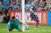 Karim Benzema of France looks as goalkeeper Noel Valladares of Honduras fails to save France's second goal during the 2014 FIFA World Cup Brazil...