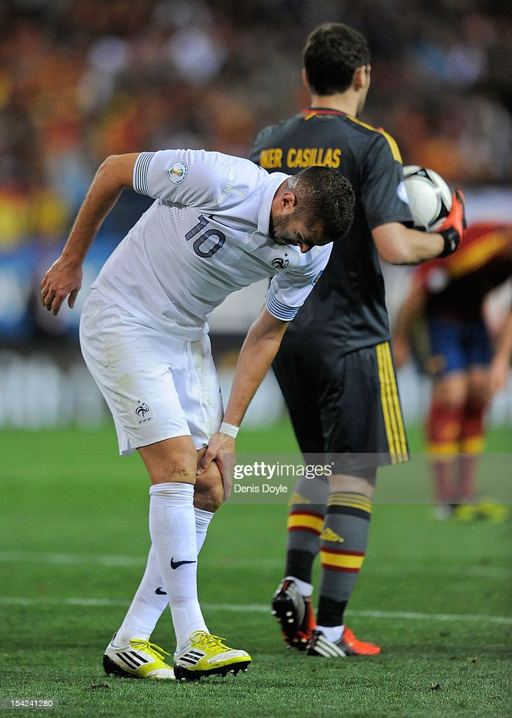 <a gi-track='captionPersonalityLinkClicked' href=/galleries/search?phrase=Karim+Benzema&family=editorial&specificpeople=796089 ng-click='$event.stopPropagation()'>Karim Benzema</a> of France reacts after injuring his knee during the FIFA 2014 World Cup Qualifier between Spain and France at estadio Vicente Calderon on October 16, 2012 in Madrid, Spain.