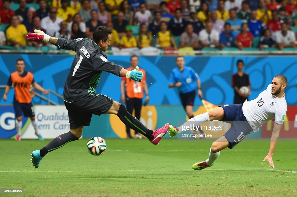 <a gi-track='captionPersonalityLinkClicked' href=/galleries/search?phrase=Karim+Benzema&family=editorial&specificpeople=796089 ng-click='$event.stopPropagation()'>Karim Benzema</a> of France scores his team's fourth goal past <a gi-track='captionPersonalityLinkClicked' href=/galleries/search?phrase=Diego+Benaglio&family=editorial&specificpeople=543817 ng-click='$event.stopPropagation()'>Diego Benaglio</a> of Switzerland during the 2014 FIFA World Cup Brazil Group E match between Switzerland and France at Arena Fonte Nova on June 20, 2014 in Salvador, Brazil.