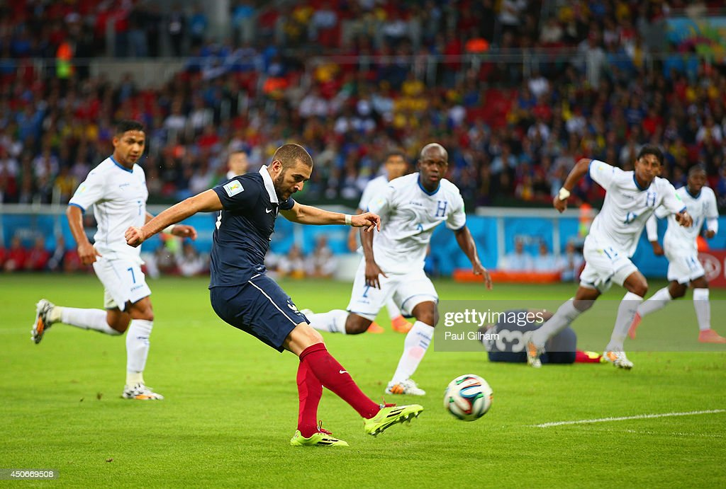 <a gi-track='captionPersonalityLinkClicked' href=/galleries/search?phrase=Karim+Benzema&family=editorial&specificpeople=796089 ng-click='$event.stopPropagation()'>Karim Benzema</a> of France shoots and scores his team's third goal, his second, during the 2014 FIFA World Cup Brazil Group E match between France and Honduras at Estadio Beira-Rio on June 15, 2014 in Porto Alegre, Brazil.