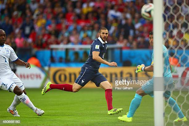 Karim Benzema of France shoots past Noel Valladares of Honduras which leads to France's second goal being scored during the 2014 FIFA World Cup...
