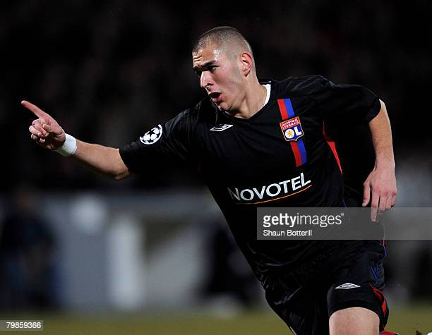 Karim Benzema of Lyon celebrates after scoring during the UEFA Champions League first knockout round first leg match between Lyon and Manchester...