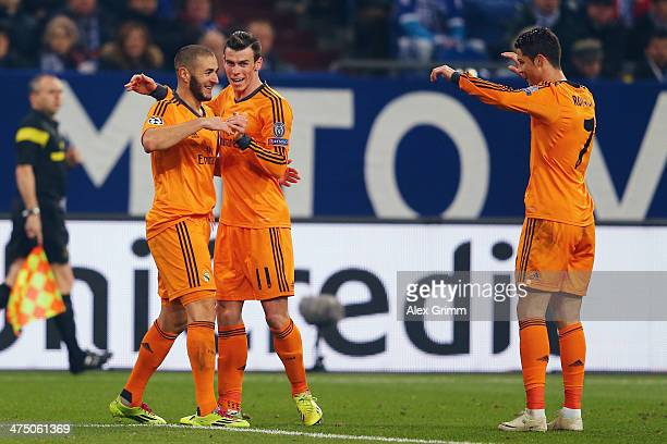 Karim Benzema of Madrid celebrates his team's fourth goal with team mates Gareth Bale and Cristiano Ronaldo during the UEFA Champions League Round of...