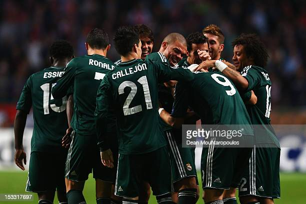 Karim Benzema of Real is congratulated by team mates after he scores his teams second goal of the game during the UEFA Champions League Group D match...