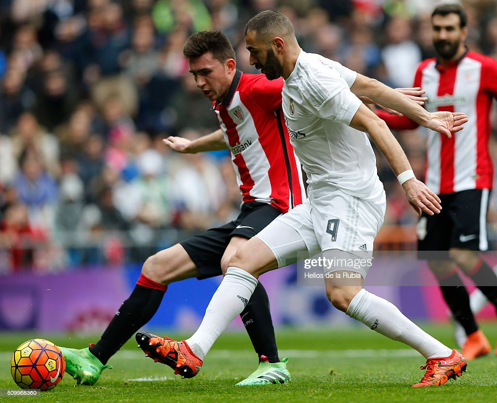 <a gi-track='captionPersonalityLinkClicked' href=/galleries/search?phrase=Karim+Benzema&family=editorial&specificpeople=796089 ng-click='$event.stopPropagation()'>Karim Benzema</a> of Real Madrid and <a gi-track='captionPersonalityLinkClicked' href=/galleries/search?phrase=Aymeric+Laporte&family=editorial&specificpeople=7894319 ng-click='$event.stopPropagation()'>Aymeric Laporte</a> of Athletic Bilbao compete for the ball during the La Liga match between Real Madrid CF and Athletic Club at Estadio Santiago Bernabeu on February 13, 2016 in Madrid, Spain.