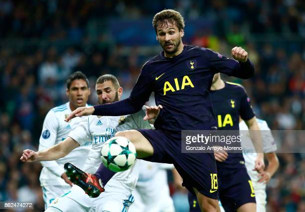 Karim Benzema of Real Madrid and Fernando Llorente of Tottenham Hotspur battle for possession during the UEFA Champions League group H match between...