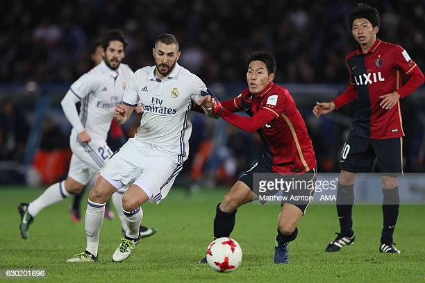 Karim Benzema of Real Madrid and Gen Shoji of Kashima Antlers during the FIFA Club World Cup final match between Real Madrid and Kashima Antlers at...