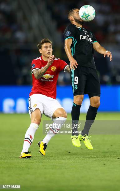 Karim Benzema of Real Madrid and Henrikh Mkhitaryan in action during Super UEFA super Cup match between Real Madrid and Manchester United on August 8...