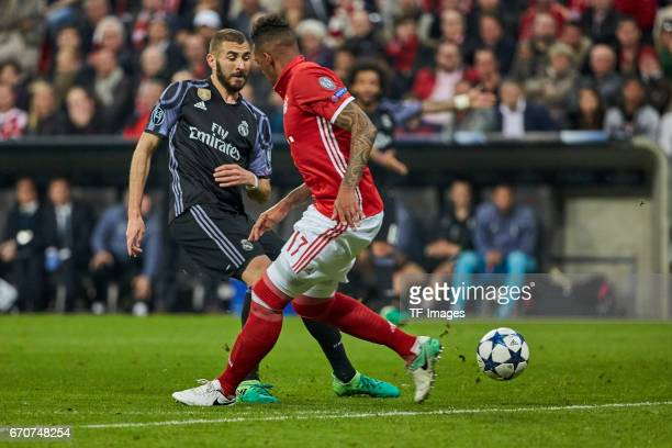 Karim Benzema of Real Madrid and Jerome Boateng of Munich battle for the ball during the UEFA Champions League Quarter Final first leg match between...