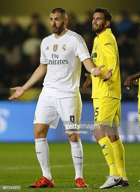 Karim Benzema of Real Madrid and Mateo Musacchio of Villarreal CF react during the La Liga match between Villarreal CF and Real Madrid CF at El...
