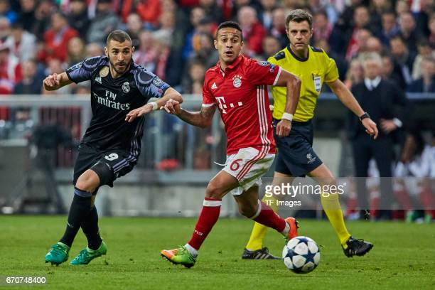 Karim Benzema of Real Madrid and Thiago of Munich battle for the ball during the UEFA Champions League Quarter Final first leg match between FC...