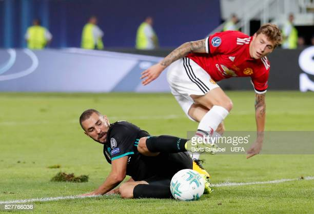 Karim Benzema of Real Madrid and Victor Lindelof of Manchester United battle for possession during the UEFA Super Cup final between Real Madrid and...