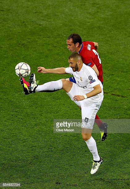 Karim Benzema of Real Madrid battles for the ball with Diego Godin of Atletico Madrid during the UEFA Champions League Final match between Real...