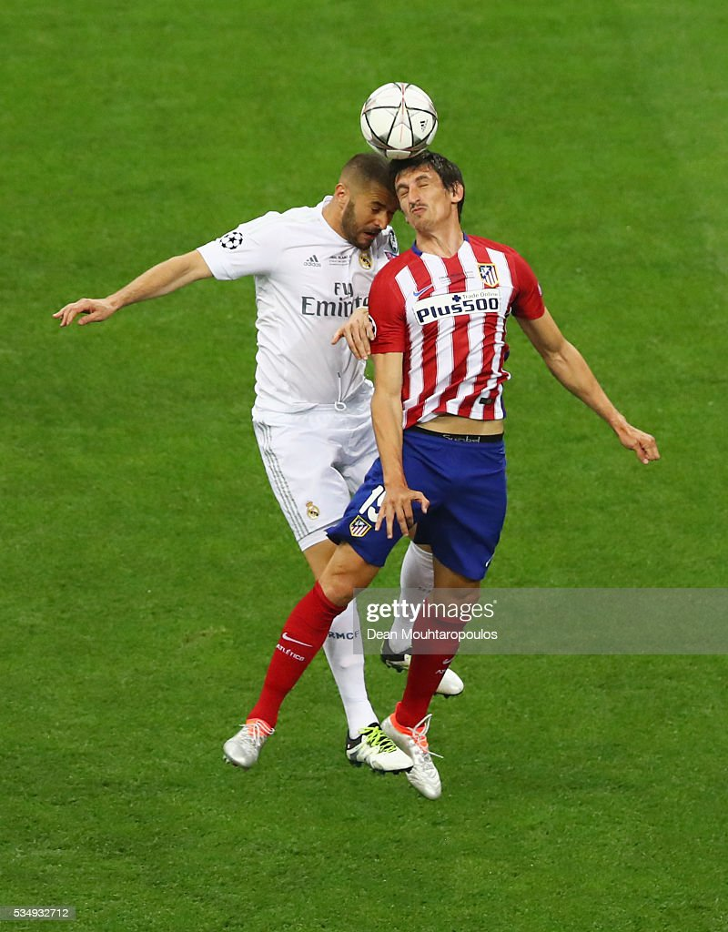 <a gi-track='captionPersonalityLinkClicked' href=/galleries/search?phrase=Karim+Benzema&family=editorial&specificpeople=796089 ng-click='$event.stopPropagation()'>Karim Benzema</a> of Real Madrid battles for the ball with <a gi-track='captionPersonalityLinkClicked' href=/galleries/search?phrase=Stefan+Savic&family=editorial&specificpeople=6135329 ng-click='$event.stopPropagation()'>Stefan Savic</a> of Atletico Madrid during the UEFA Champions League Final match between Real Madrid and Club Atletico de Madrid at Stadio Giuseppe Meazza on May 28, 2016 in Milan, Italy.