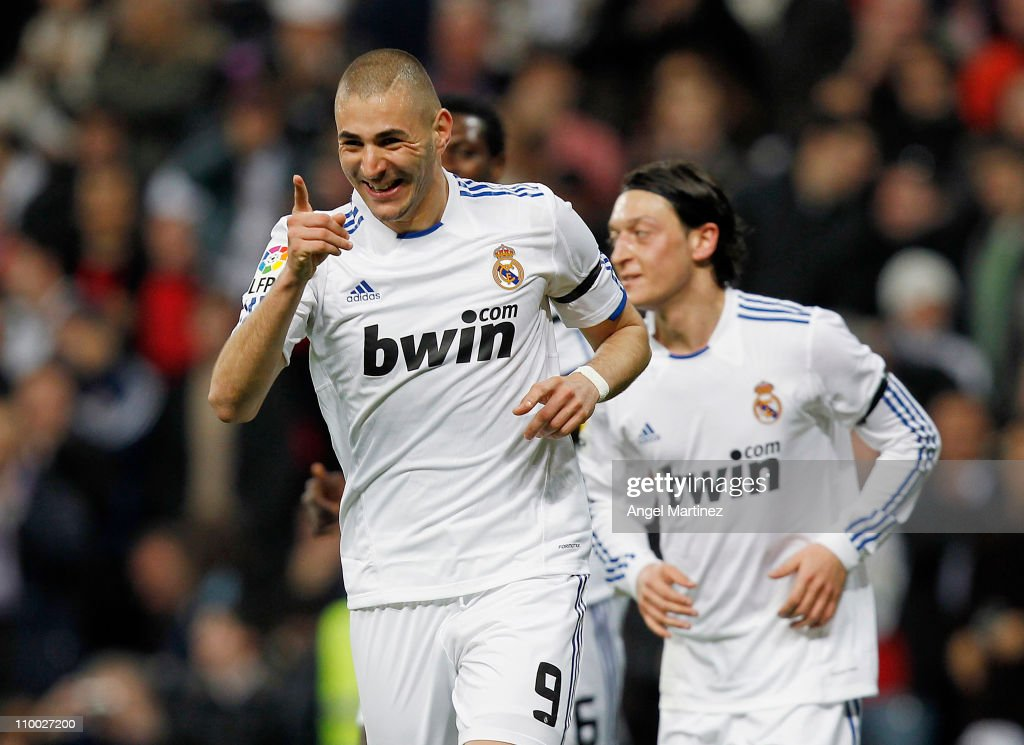 Karim Benzema of Real Madrid celebrates after scoring his side opening goal during the La Liga match between Real Madrid and Hercules at Estadio Santiago Bernabeu on March 12, 2011 in Madrid, Spain.